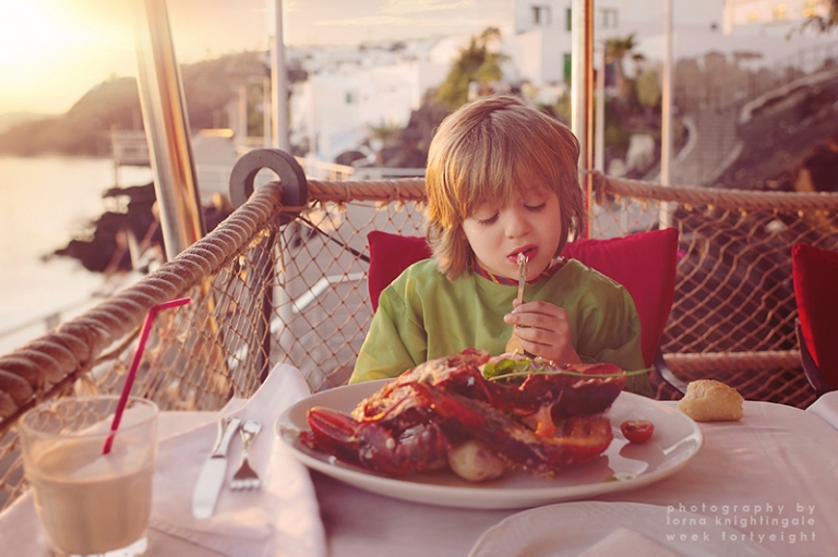 little one eating lobster